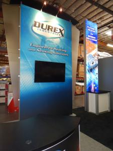 RENTAL: (2) 15 ft. High Double-Sided Lightbox Kiosks with RE-1202 Rectangular Counters, (2) RE-1205 Large Curved Counters, 60 in. Monitor, and SEG Fabric Graphics, and Direct Print Sintra Counter Graphics